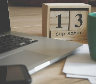 Canva - Brown Wooden Block Desk Calendar Displaying September 13 - copia